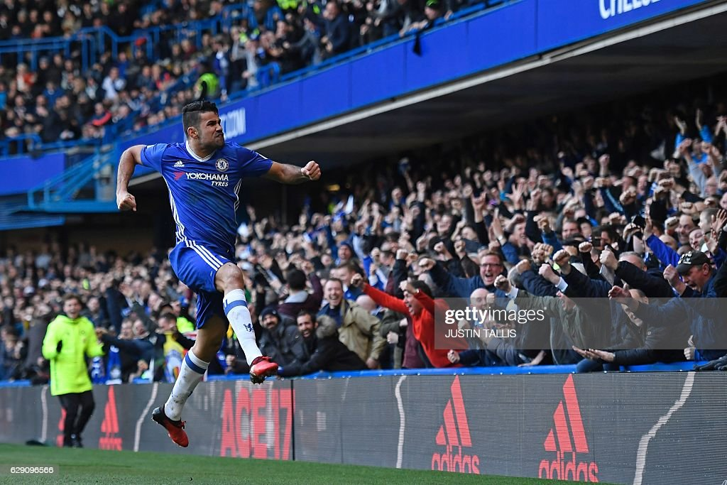 Chelsea's Brazilian-born Spanish striker Diego Costa celebrates after scoring the opening goal of the English Premier League football match between Chelsea and West Bromwich Albion at Stamford Bridge in London on December 11, 2016. / AFP / Justin TALLIS / RESTRICTED TO EDITORIAL USE. No use with unauthorized audio, video, data, fixture lists, club/league logos or 'live' services. Online in-match use limited to 75 images, no video emulation. No use in betting, games or single club/league/player publications. /