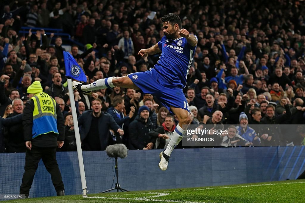 Chelsea's Brazilian-born Spanish striker Diego Costa celebrates after scoring their fourth goal during the English Premier League football match between Chelsea and Stoke City at Stamford Bridge in London on December 31, 2016. Chelsea won the game 4-2. / AFP / Ian KINGTON / RESTRICTED TO EDITORIAL USE. No use with unauthorized audio, video, data, fixture lists, club/league logos or 'live' services. Online in-match use limited to 75 images, no video emulation. No use in betting, games or single club/league/player publications. /