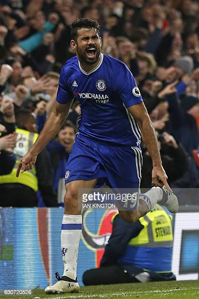 Chelsea's Brazilianborn Spanish striker Diego Costa celebrates after scoring their fourth goal during the English Premier League football match...