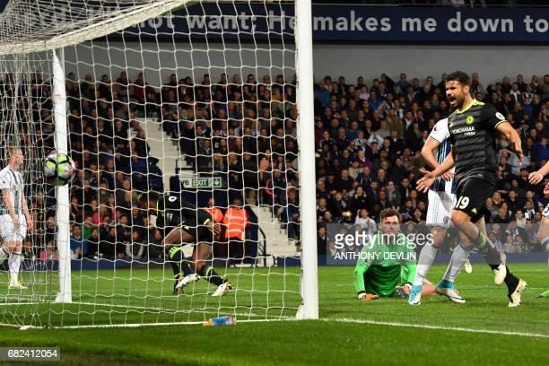 Chelsea's Brazilianborn Spanish striker Diego Costa celebrates as Chelsea's Belgian striker Michy Batshuayi scores the opening goal past West...