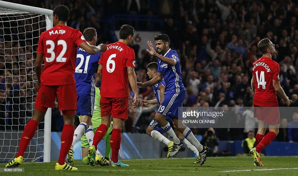 Chelsea's Brazilian-born Spanish striker Diego Costa (C) celebrates score his team's first goal, as Liverpool's Croatian defender Dejan Lovren and Liverpool's English midfielder Jordan Henderson react during the English Premier League football match between Chelsea and Liverpool at Stamford Bridge in London on September 16, 2016. / AFP / Adrian DENNIS / RESTRICTED TO EDITORIAL USE. No use with unauthorized audio, video, data, fixture lists, club/league logos or 'live' services. Online in-match use limited to 75 images, no video emulation. No use in betting, games or single club/league/player publications. /