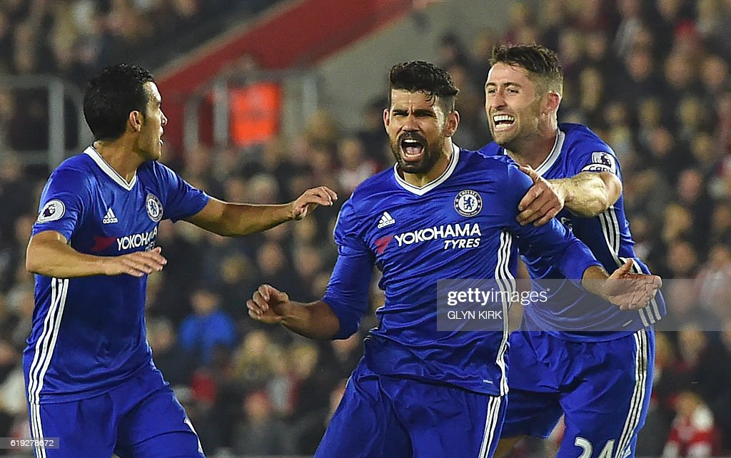 Chelsea's Brazilian-born Spanish striker Diego Costa (C) celebrates scoring their second goal with Chelsea's Spanish midfielder Pedro (L) and Chelsea's English defender Gary Cahill (R) during the English Premier League football match between Southampton and Chelsea at St Mary's Stadium in Southampton, southern England on October 30, 2016. / AFP / GLYN KIRK / RESTRICTED TO EDITORIAL USE. No use with unauthorized audio, video, data, fixture lists, club/league logos or 'live' services. Online in-match use limited to 75 images, no video emulation. No use in betting, games or single club/league/player publications. /
