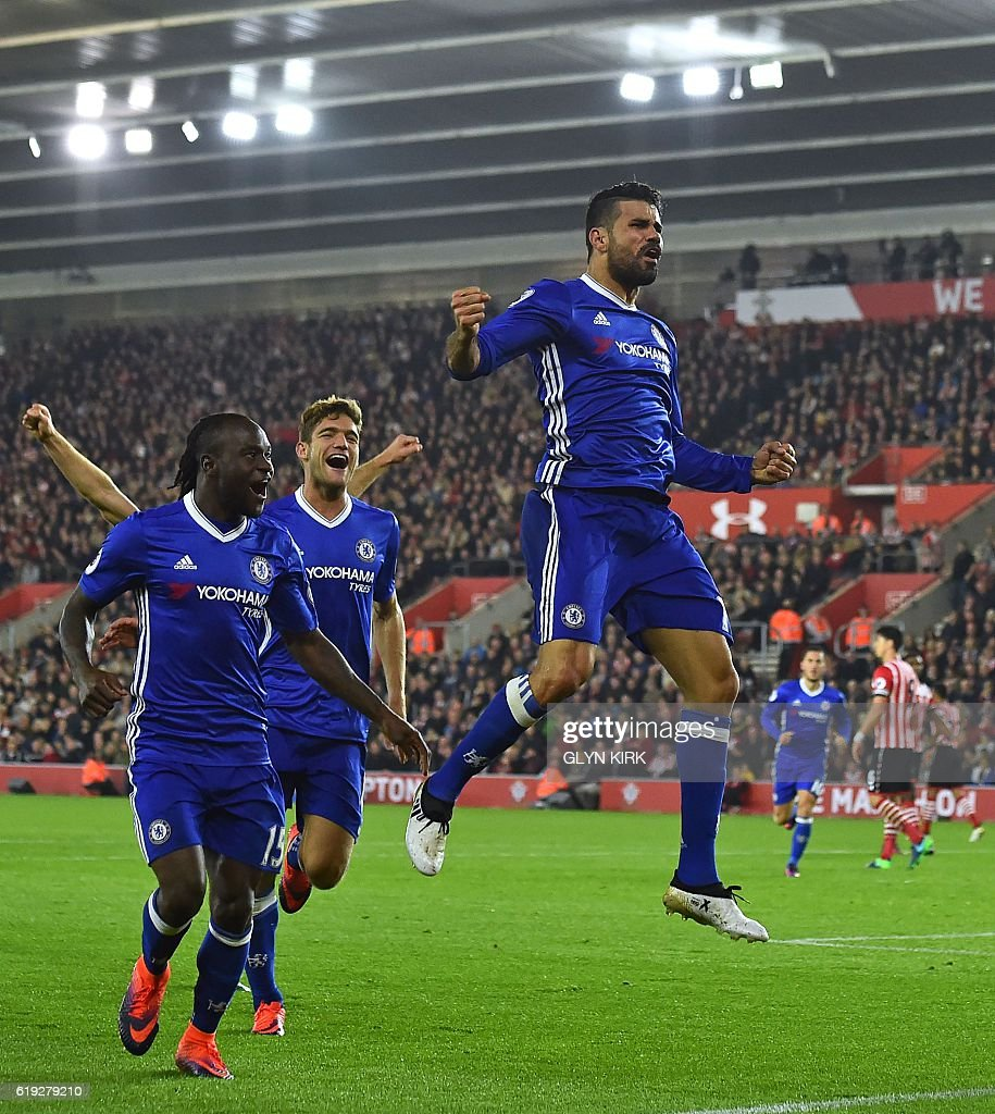 Chelsea's Brazilian-born Spanish striker Diego Costa (R) celebrates scoring their second goal during the English Premier League football match between Southampton and Chelsea at St Mary's Stadium in Southampton, southern England on October 30, 2016. / AFP / GLYN KIRK / RESTRICTED TO EDITORIAL USE. No use with unauthorized audio, video, data, fixture lists, club/league logos or 'live' services. Online in-match use limited to 75 images, no video emulation. No use in betting, games or single club/league/player publications. /