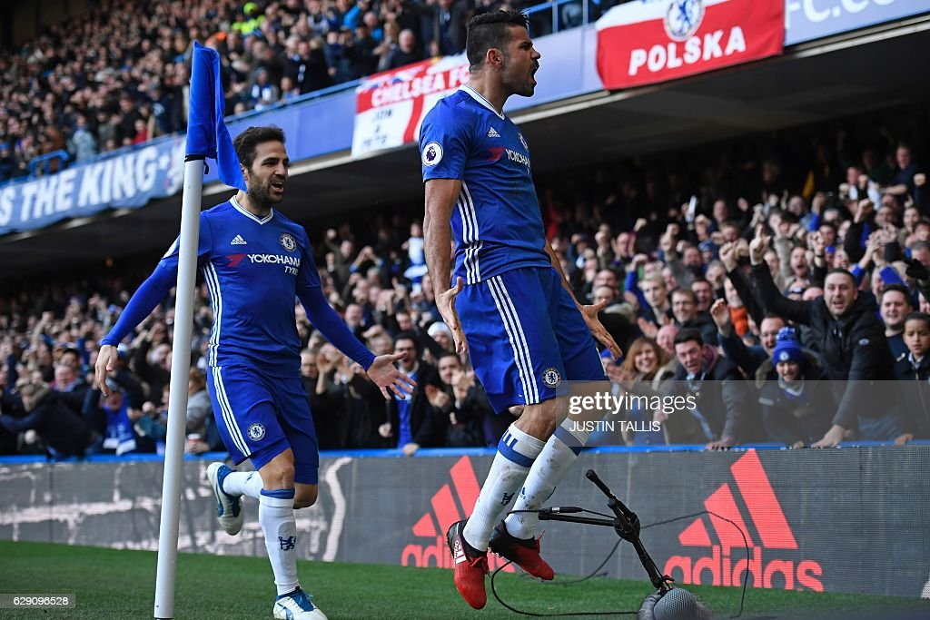 Chelsea's Brazilian-born Spanish striker Diego Costa celebrates with Chelsea's Spanish midfielder Cesc Fabregas (L) after scoring the opening goal of the English Premier League football match between Chelsea and West Bromwich Albion at Stamford Bridge in London on December 11, 2016. / AFP / Justin TALLIS / RESTRICTED TO EDITORIAL USE. No use with unauthorized audio, video, data, fixture lists, club/league logos or 'live' services. Online in-match use limited to 75 images, no video emulation. No use in betting, games or single club/league/player publications. /