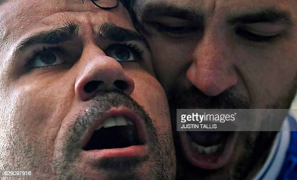 Chelsea's Brazilianborn Spanish striker Diego Costa celebrates with Chelsea's Spanish midfielder Cesc Fabregas after scoring the opening goal of the...