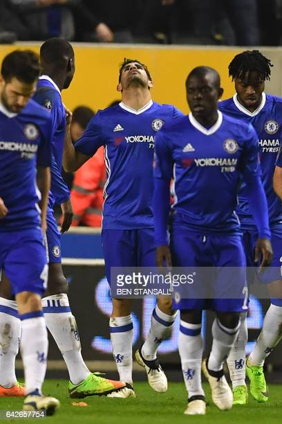 Chelsea's Brazilianborn Spanish striker Diego Costa celebrates with teammates after scoring their second goal during the English FA Cup fifth round...