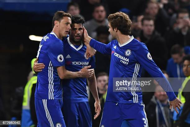 Chelsea's Brazilianborn Spanish striker Diego Costa celebrates with Chelsea's Serbian midfielder Nemanja Matic and Chelsea's Spanish defender Marcos...