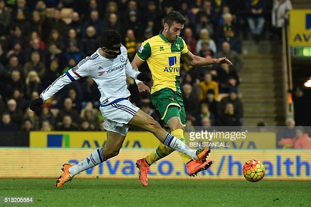 Chelsea's Brazilianborn Spanish striker Diego Costa challenges Norwich City's English midfielder Jacob Murphy during the English Premier League...