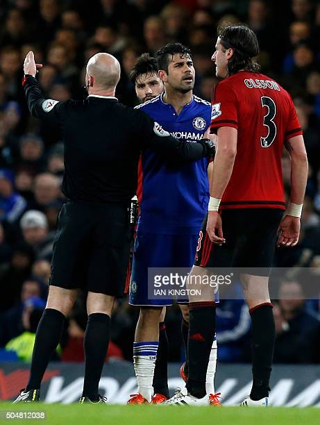 Chelsea's Brazilianborn Spanish striker Diego Costa clashes with West Bromwich Albion's Swedish defender Jonas Olsson during the English Premier...