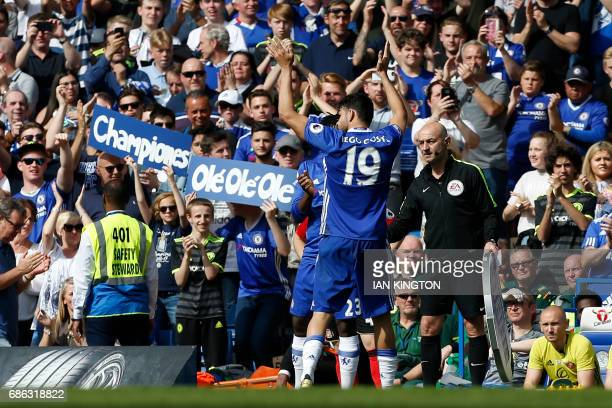 Chelsea's Brazilianborn Spanish striker Diego Costa gestures to the crowd as he's substituted during the English Premier League football match...