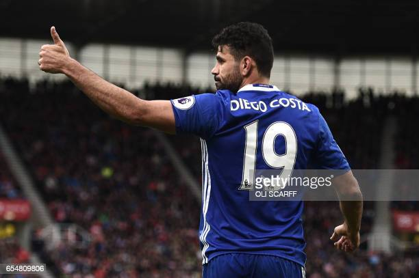 Chelsea's Brazilianborn Spanish striker Diego Costa gives a thumbs up during the English Premier League football match between Stoke City and Chelsea...