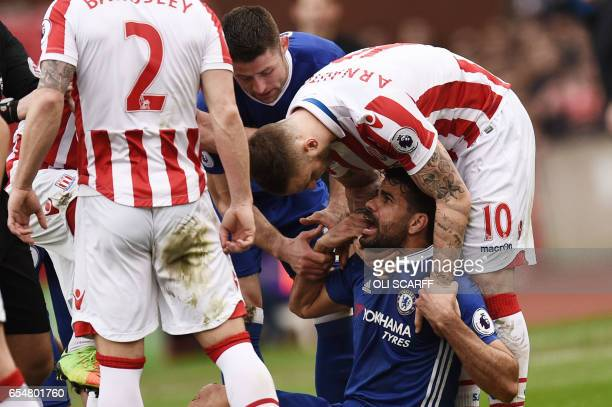 Chelsea's Brazilianborn Spanish striker Diego Costa has words with Stoke City's Englishborn Scottish defender Phil Bardsley and Stoke City's Austrian...