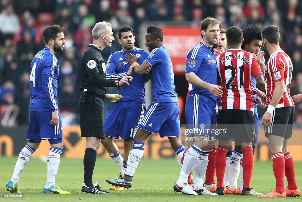 Chelsea's Brazilian-born Spanish striker Diego Costa (3rd L) is calmed by Chelsea's Nigerian midfielder John Obi Mikel during the English Premier League football match between Southampton and Chelsea at St Mary's Stadium in Southampton, southern England on February 27, 2016. Chelsea won the game 2-1. / AFP / JUSTIN TALLIS / RESTRICTED TO EDITORIAL USE. No use with unauthorized audio, video, data, fixture lists, club/league logos or 'live' services. Online in-match use limited to 75 images, no video emulation. No use in betting, games or single club/league/player publications. /