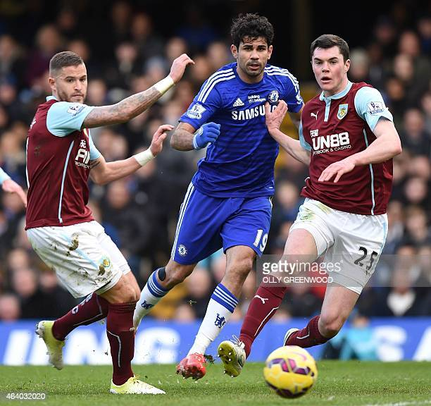 Chelsea's Brazilianborn Spanish striker Diego Costa is challenged by Burnley's English defender Michael Keane during the English Premier League...