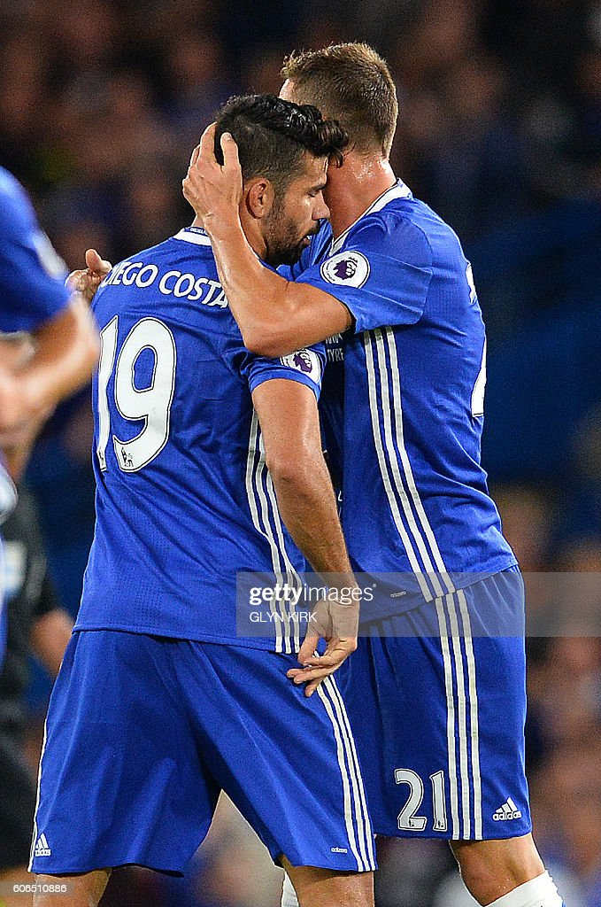 Chelsea's Brazilian-born Spanish striker Diego Costa (L) is congratulated by Chelsea's Serbian midfielder Nemanja Matic after scoring his team's first goal during the English Premier League football match between Chelsea and Liverpool at Stamford Bridge in London on September 16, 2016. / AFP / GLYN KIRK / RESTRICTED TO EDITORIAL USE. No use with unauthorized audio, video, data, fixture lists, club/league logos or 'live' services. Online in-match use limited to 75 images, no video emulation. No use in betting, games or single club/league/player publications. /