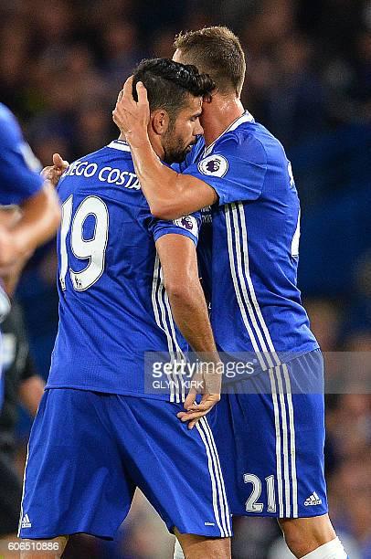 Chelsea's Brazilianborn Spanish striker Diego Costa is congratulated by Chelsea's Serbian midfielder Nemanja Matic after scoring his team's first...