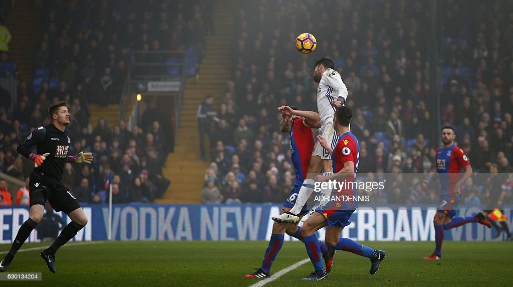 Chelsea's Brazilian-born Spanish striker Diego Costa (C) jumps to head the ball and score his team's first goal during the English Premier League football match between Crystal Palace and Chelsea at Selhurst Park in south London on December 17, 2016. / AFP / Adrian DENNIS / RESTRICTED TO EDITORIAL USE. No use with unauthorized audio, video, data, fixture lists, club/league logos or 'live' services. Online in-match use limited to 75 images, no video emulation. No use in betting, games or single club/league/player publications. /