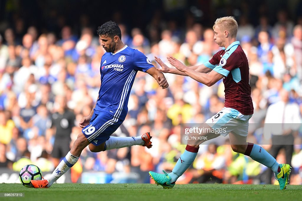 TOPSHOT - Chelsea's Brazilian-born Spanish striker Diego Costa (L) passes by Burnley's English striker Andre Gray during the English Premier League football match between Chelsea and Burnley at Stamford Bridge in London on August 27, 2016. / AFP / GLYN KIRK / RESTRICTED TO EDITORIAL USE. No use with unauthorized audio, video, data, fixture lists, club/league logos or 'live' services. Online in-match use limited to 75 images, no video emulation. No use in betting, games or single club/league/player publications. /