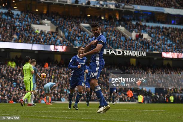 Chelsea's Brazilianborn Spanish striker Diego Costa points tho his black armband as he celebrates scoring his team's first goal during the English...