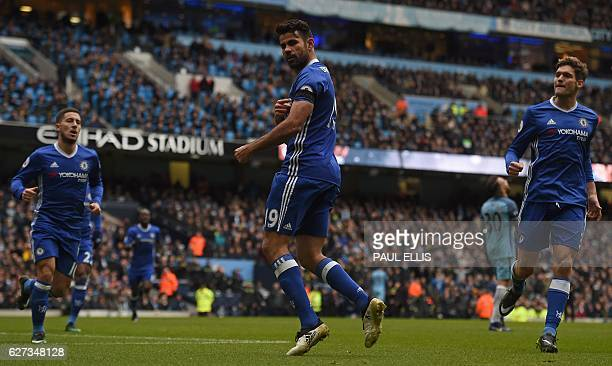 Chelsea's Brazilianborn Spanish striker Diego Costa points to his black armband as he celebrates scoring his team's first goal during the English...