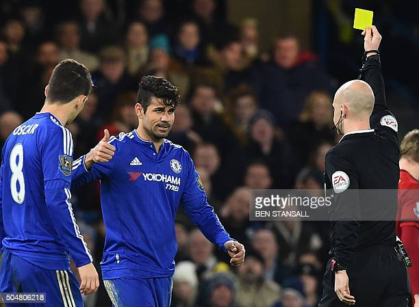 Chelsea's Brazilianborn Spanish striker Diego Costa reacts to being shown a yellow card from referee Anthony Taylor during the English Premier League...
