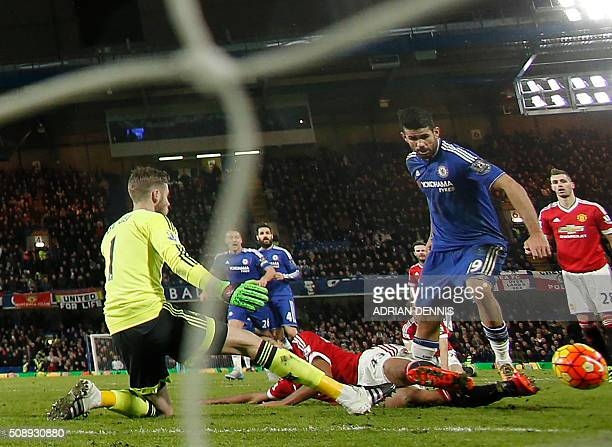 Chelsea's Brazilianborn Spanish striker Diego Costa rounds Manchester United's Spanish goalkeeper David de Gea to score during the English Premier...