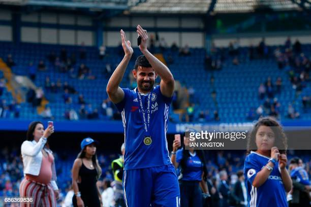 Chelsea's Brazilianborn Spanish striker Diego Costa salutes the crowd at the end of the presentation ceremony for the English Premier League trophy...