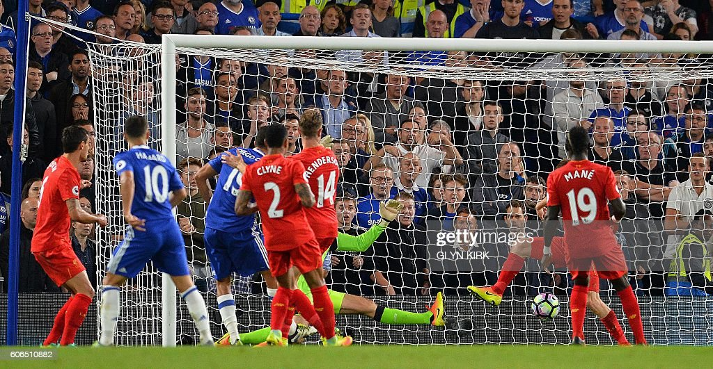 Chelsea's Brazilian-born Spanish striker Diego Costa (3L) scores his team's first goal during the English Premier League football match between Chelsea and Liverpool at Stamford Bridge in London on September 16, 2016. / AFP / GLYN KIRK / RESTRICTED TO EDITORIAL USE. No use with unauthorized audio, video, data, fixture lists, club/league logos or 'live' services. Online in-match use limited to 75 images, no video emulation. No use in betting, games or single club/league/player publications. /