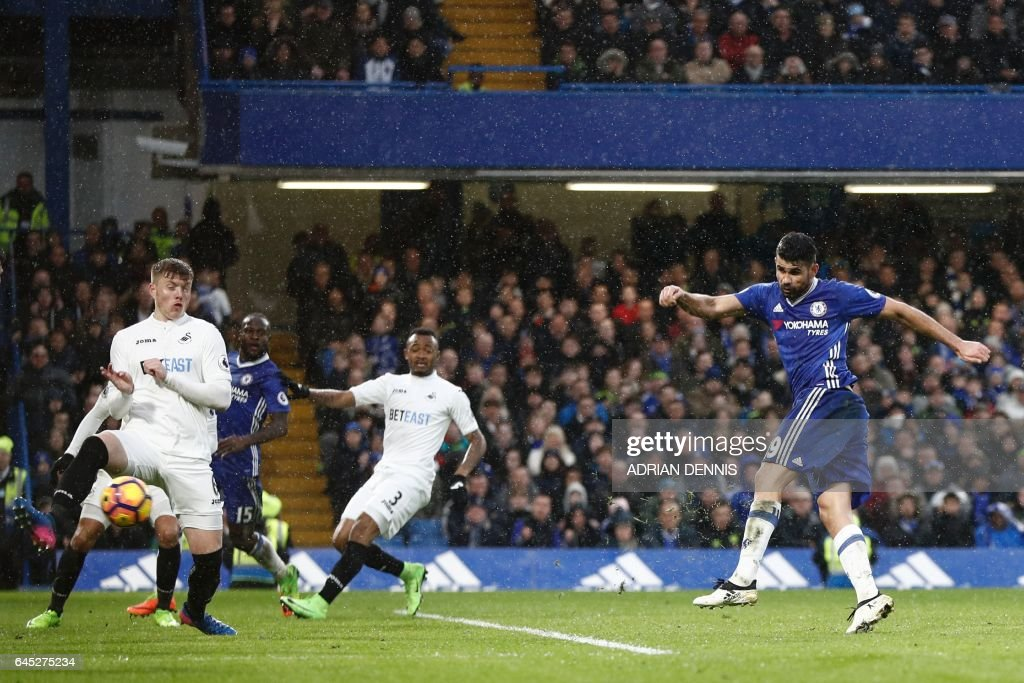 Chelsea's Brazilian-born Spanish striker Diego Costa (R) scores their third goal during the English Premier League football match between Chelsea and Swansea at Stamford Bridge in London on February 25, 2017. / AFP / Adrian DENNIS / RESTRICTED TO EDITORIAL USE. No use with unauthorized audio, video, data, fixture lists, club/league logos or 'live' services. Online in-match use limited to 75 images, no video emulation. No use in betting, games or single club/league/player publications. /
