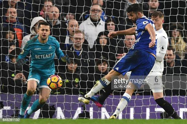 Chelsea's Brazilianborn Spanish striker Diego Costa scores their third goal during the English Premier League football match between Chelsea and...