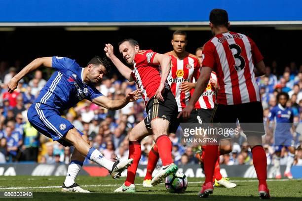 Chelsea's Brazilianborn Spanish striker Diego Costa shoots past Sunderland's Irish defender John O'Shea during the English Premier League football...