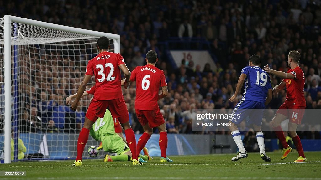 Chelsea's Brazilian-born Spanish striker Diego Costa (2R) shoots past Liverpool's Croatian defender Dejan Lovren (C) and Liverpool's English midfielder Jordan Henderson (R) to score his team's first goal during the English Premier League football match between Chelsea and Liverpool at Stamford Bridge in London on September 16, 2016. / AFP / Adrian DENNIS / RESTRICTED TO EDITORIAL USE. No use with unauthorized audio, video, data, fixture lists, club/league logos or 'live' services. Online in-match use limited to 75 images, no video emulation. No use in betting, games or single club/league/player publications. /