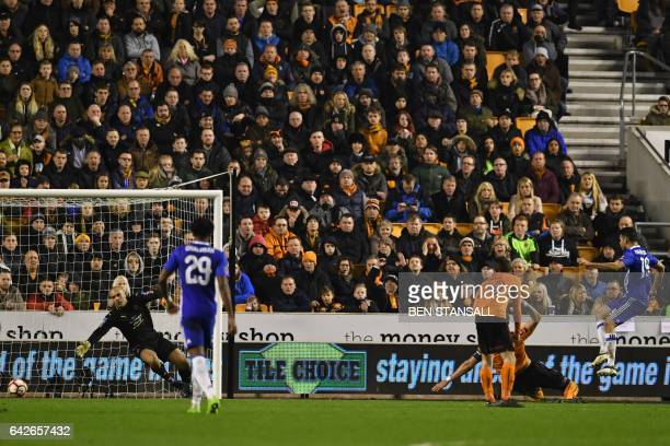 Chelsea's Brazilianborn Spanish striker Diego Costa shoots past Wolverhampton Wanderers' English goalkeeper Carl Ikeme to score their second goal...