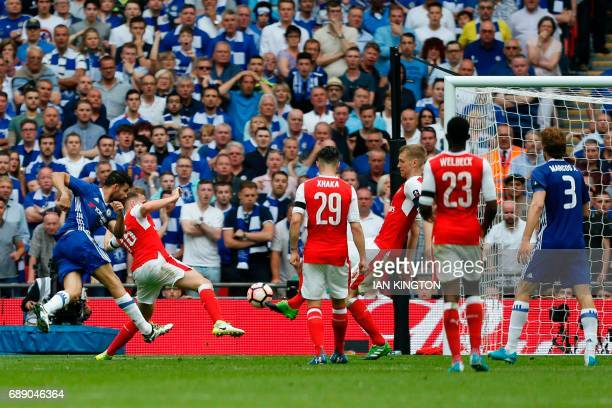 Chelsea's Brazilianborn Spanish striker Diego Costa shoots to score their first goal during the English FA Cup final football match between Arsenal...