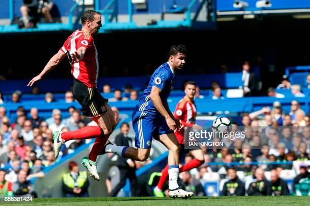 Chelsea's Brazilianborn Spanish striker Diego Costa takes on Sunderland's Irish defender John O'Shea during the English Premier League football match...
