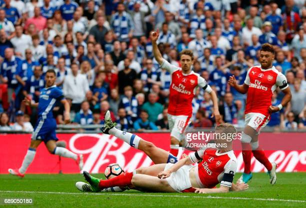 Chelsea's Brazilianborn Spanish striker Diego Costa vies with Arsenal's German defender Per Mertesacker during the English FA Cup final football...