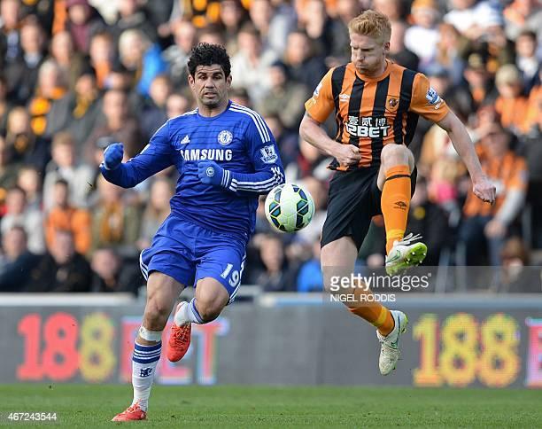 Chelsea's Brazilianborn Spanish striker Diego Costa vies with Hull City's Irish defender Paul McShane during the English Premier League football...