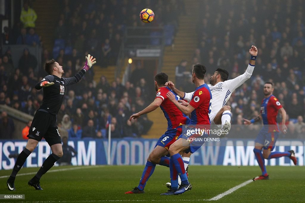 Chelsea's Brazilian-born Spanish striker Diego Costa (2R) watches the ball after jumping to head and score his team's first goal during the English Premier League football match between Crystal Palace and Chelsea at Selhurst Park in south London on December 17, 2016. / AFP / Adrian DENNIS / RESTRICTED TO EDITORIAL USE. No use with unauthorized audio, video, data, fixture lists, club/league logos or 'live' services. Online in-match use limited to 75 images, no video emulation. No use in betting, games or single club/league/player publications. /