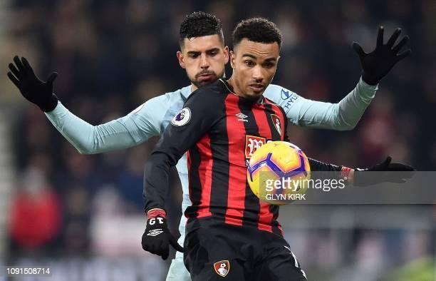TOPSHOT Chelsea's BrazilianItalian defender Emerson Palmieri vies with Bournemouth's English midfielder Junior Stanislas during the English Premier...