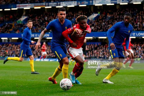 Chelsea's BrazilianItalian defender Emerson Palmieri vies with Nottingham Forest's English midfielder Alex Mighten during the English FA Cup third...