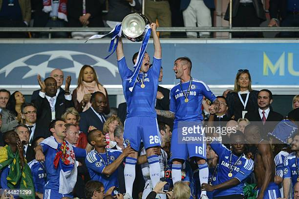 Chelsea's British defender John Terry holds the trophy after the UEFA Champions League final football match between FC Bayern Muenchen and Chelsea FC...