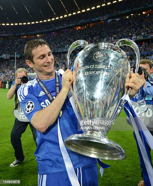 Chelsea's British midfielder Frank Lampard holds the trophy after the UEFA Champions League final football match between FC Bayern Muenchen and...