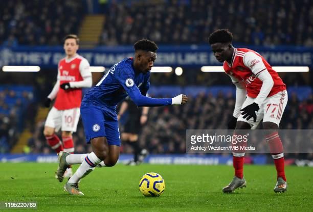 Chelsea's Callum HudsonOdoi takes on Arsenal's Bukayo Saka during the Premier League match between Chelsea FC and Arsenal FC at Stamford Bridge on...