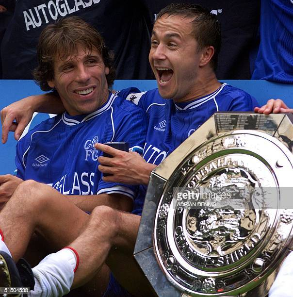 Chelsea's captain Dennis Wise laughs with team mate Gianfranco Zola after winning the FA Charity Shield at Wembley stadium in London 13 August 2000...