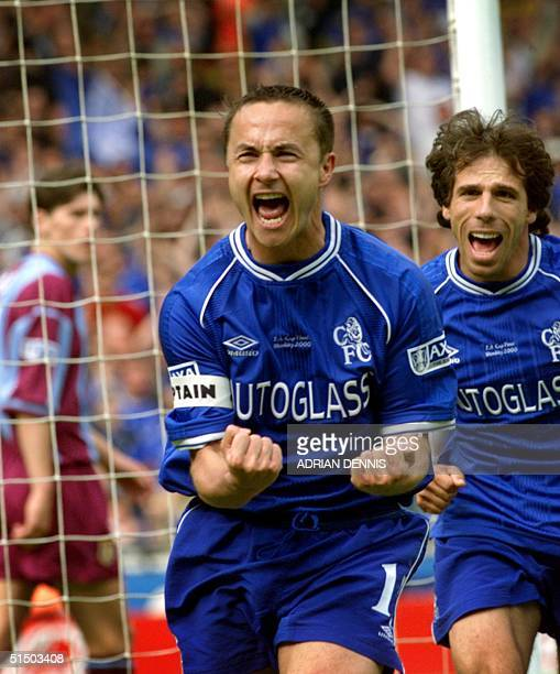 Chelsea's captain Dennis Wise runs towards the fans followed by Gianfranco Zola after Wise thought he's scored during the second half of the FA Cup...