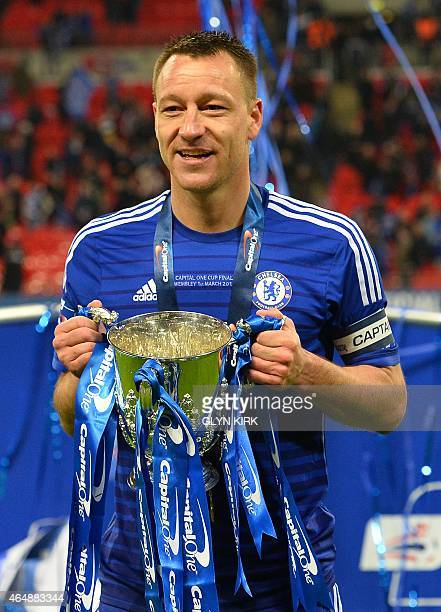 Chelsea's captain English defender John Terry celebrates with the trophy during the presentation after Chelsea won the League Cup final football...