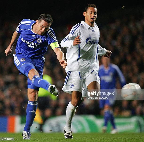 Chelsea's Captain English midfielder Frank Lampard tries to shoot at goal past FC Schalke 04's Jermaine Jones during their Champions League football...