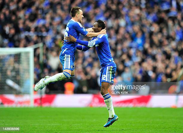 Chelsea's captain John Terry and Nigerian midfielder John Obi Mikel celebrate their 21 win at the final whistle of the FA Cup final football match...