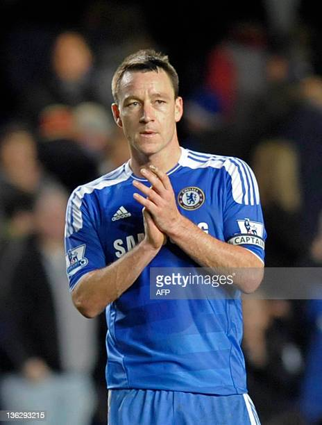 Chelsea's captain John Terry applauds the supporters after their 13 defeat in the English Premier League football match between Chelsea and Aston...