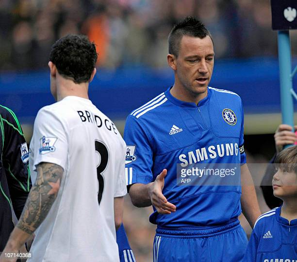 Chelsea's captain John Terry fails to get a hand shake from Manchester City's English defender Wayne Bridge before the English Premier League...
